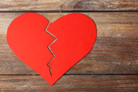mended: Broken heart on wooden planks background