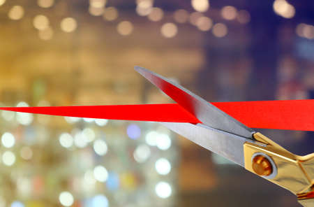 cut: Scissors cutting red ribbon