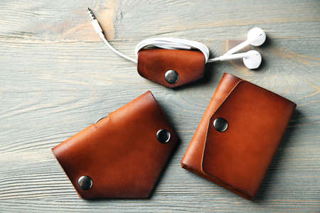leather: Hand made leather man accessories on wooden background