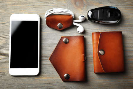 man made object: Hand made leather man accessories on white wooden background