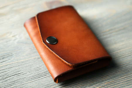 Hand made leather man wallet on wooden background Zdjęcie Seryjne