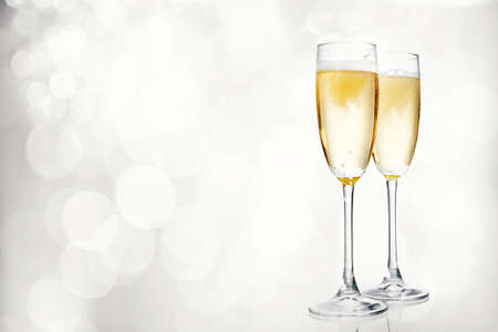 Glasses of champagne on bright background 스톡 콘텐츠