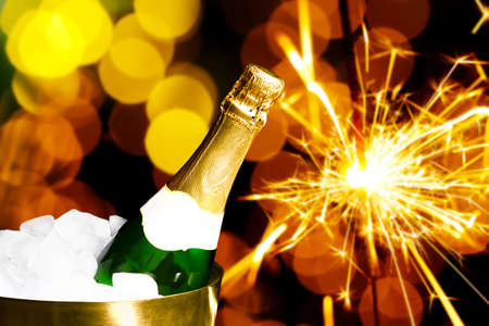 champagne: Bottle of champagne in bucket with ice, on bright background Stock Photo
