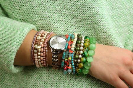 bangles hand: Stylish bracelets and clock on female hand close-up