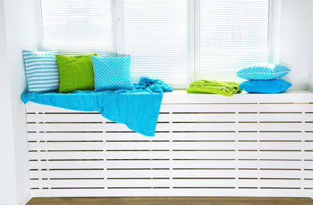 windowsill: Colorful pillows on windowsill