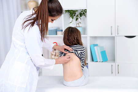 Little girl and young doctor in hospital Stock Photo