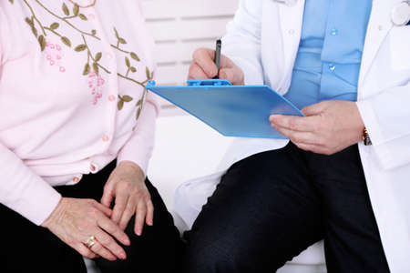 doctor's office: Doctor and patient in hospital clinic