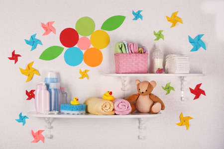 shoe shelf: Baby accessories on shelves close-up