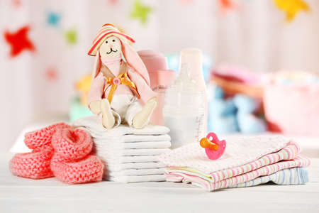 body milk: Baby accessories on table on light background Stock Photo