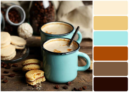 paleta de pintor: Tasty cappuccino on table and palette of colors