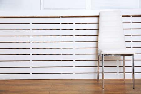 modern chair: Modern chair on white wooden planks background