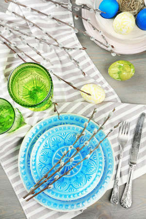 table decoration: Easter table setting on color wooden background Stock Photo