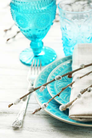 pussy willow: Easter table setting with pussy willow branches on color wooden background