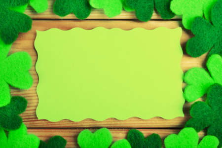 shamrock: Greeting card for Saint Patricks Day with shamrocks on wooden planks background