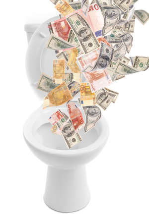 mucho dinero: A lot of money is flushed down the toilet, isolated on white