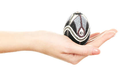 lady hand: Easter egg in female hand isolated on white