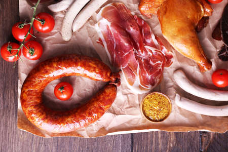 deli: Assortment of deli meats on parchment, top view