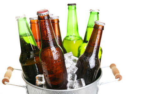 ice bucket: Glass bottles of beer in metal bucket isolated on white