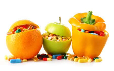 bellpepper: Orange fruit, apple and bell-pepper and colorful pills, isolated on white