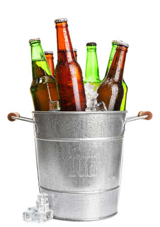 beer bucket: Glass bottles of beer in metal bucket isolated on white