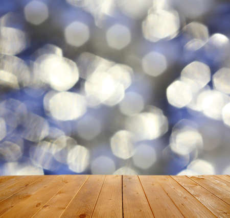 garish: Wooden table  with abstract  blur background