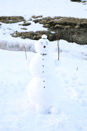 wintertime: Funny snowman over snow in wintertime Stock Photo