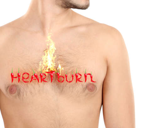 heartburn: Word Heartburn made with red hot peppers on mans body, Heartburn concept