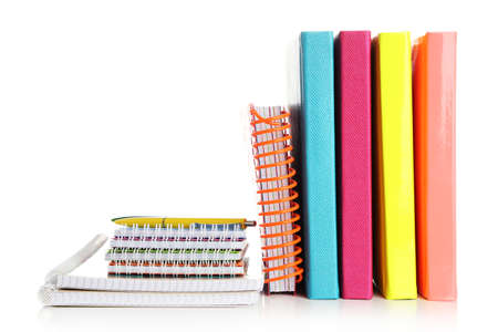 notebook: Colorful notebooks and pen, isolated on white