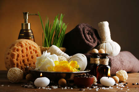 scrub grass: Composition of spa treatment on wooden table, on dark color background
