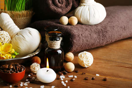 scrub grass: Composition of spa treatment on wooden table background