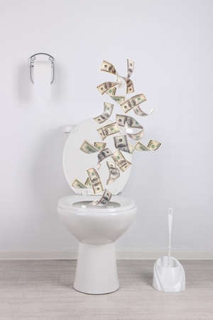 A lot of money is flushed down the toilet. 版權商用圖片