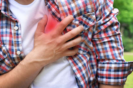 pain: Man having chest pain - heart attack, outdoors Stock Photo