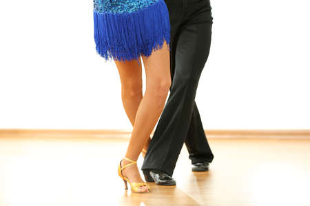 womanish: Beautiful womanish and masculine legs in active ballroom dance, indoors
