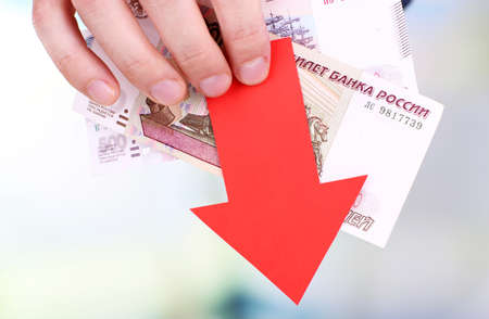 man holding money: Man holding money and red arrow close up