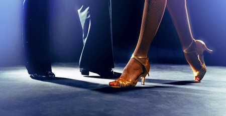 ballroom dancing: Feet partners on black background Stock Photo