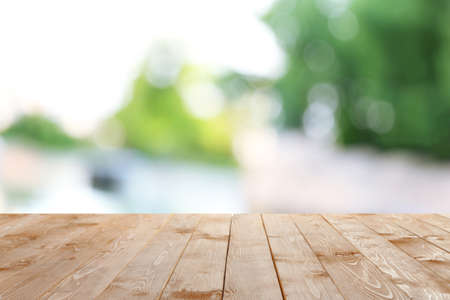 escapement: Wooden table  with abstract  blur background
