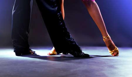 Feet partners on black background Stockfoto
