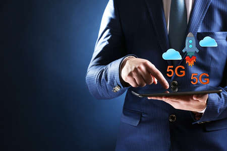 high speed: Business man use tablet PC on 5G high speed network communication internet. Stock Photo