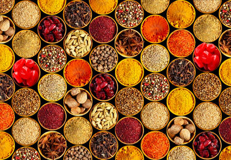 different: Different spices on black background