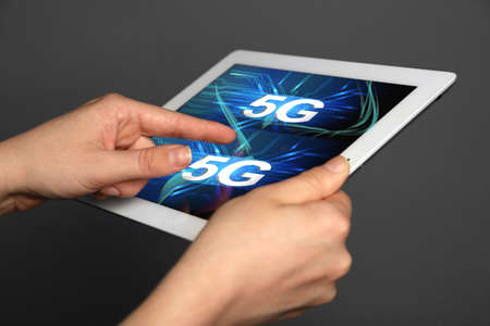 high speed internet: Woman use tablet PC on 5G high speed network communication internet. Stock Photo