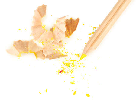 sharpening: Wooden color pencil with sharpening shavings, isolated on white Stock Photo