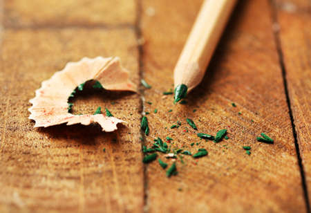 sharpening: Wooden color pencil with sharpening shavings on wooden table