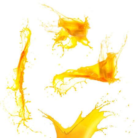 Orange juice splashes isolated on white Stock Photo