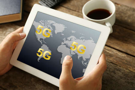high speed internet: Business man use tablet PC on 5G high speed network communication internet. Stock Photo