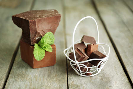 wicker bar: Still life with set of chocolate on wooden background