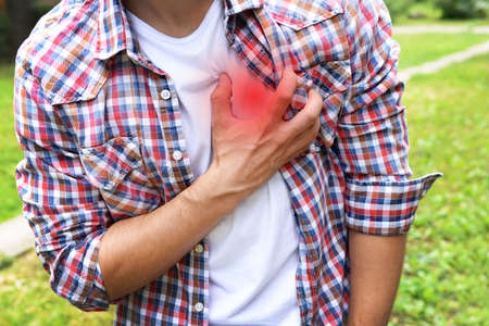 chest pain: Man having chest pain - heart attack, outdoors Stock Photo