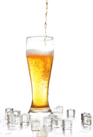 abstract liquor: Pouring beer into glass isolated on white