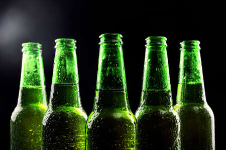 green beer bottle: glass bottles of beer on dark background Stock Photo