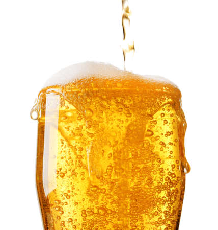 pouring beer: Pouring beer into glass isolated on white