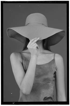 covering the face: Retro Woman Portrait covering face using hat